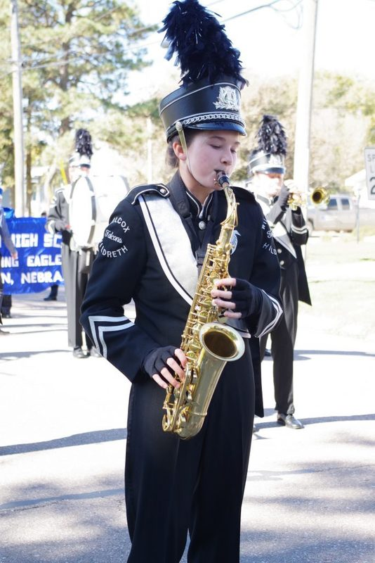 Student playing the saxophone in the band
